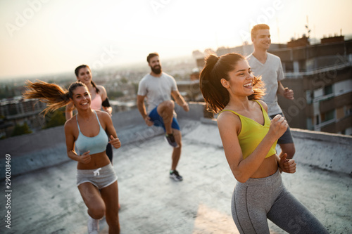 Fitness, sport, friendship and healthy lifestyle concept . Group of happy people exercising - 290208469