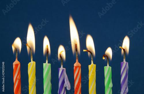 Fototapeta  Eight birthday candles on blue background