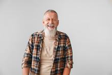 Happy Mature Man On Grey Background
