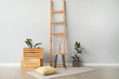canvas print picture Table with wooden boxes and ladder near light wall in room