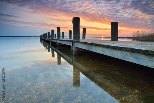 Lake with wooden Pier at Sunrise