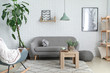 Stylish interior of room with soft couch