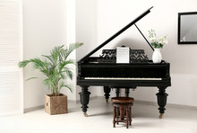 Black Grand Piano In Interior Of Room