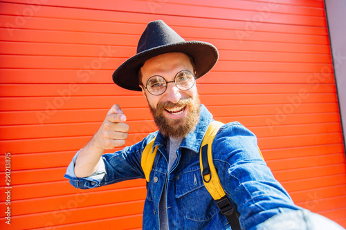 Portrait of happy excited hipster man traveler Tablou Canvas