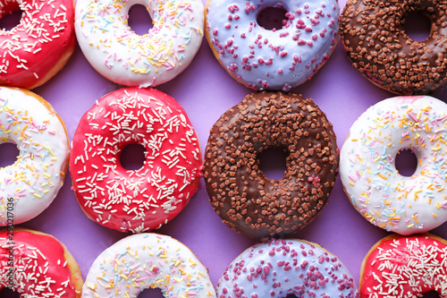 Deurstickers Dessert Different tasty donuts on color background