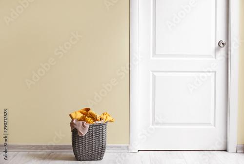 Obraz na plátně  Basket with laundry on floor in room