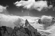 Leinwanddruck Bild Black and white view on snowy high mountains peak