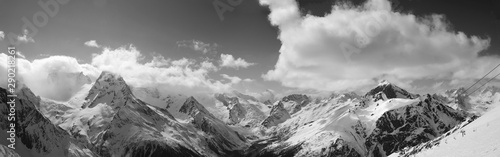 Deurstickers Grijs Black and white panorama of snowy sunlit mountains