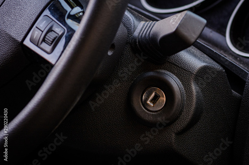 Poster Fitness Ignition lock, dashboard and wheel of a car
