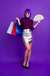 canvas print picture Vertical full body photo of stylish lady holding packs and fan of bucks wear trendy outfit isolated purple background