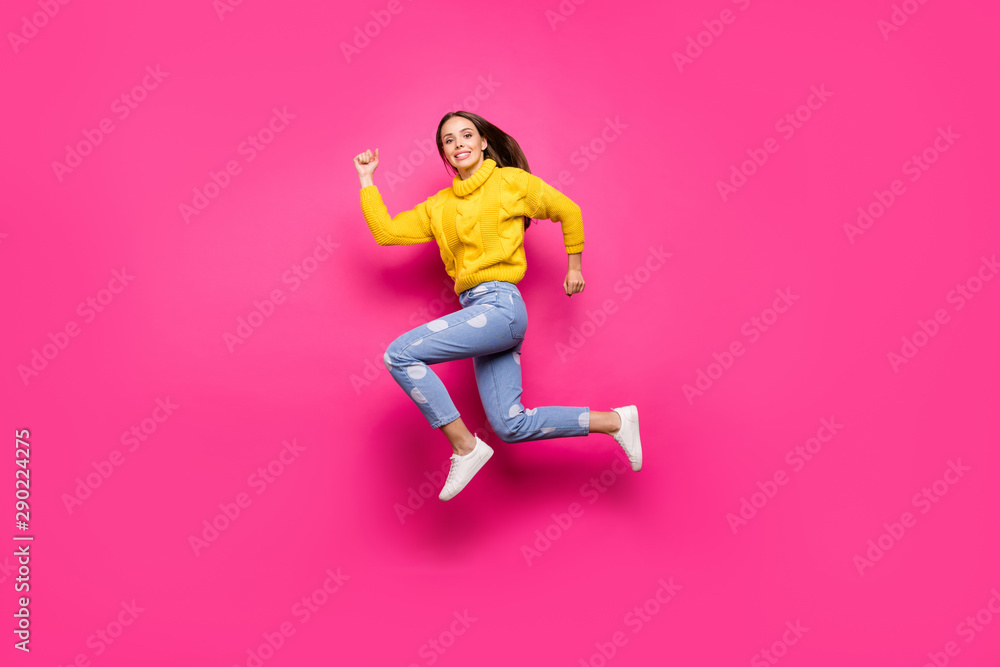 Fototapety, obrazy: Full length photo of lovely girl jumping running wearing yellow pullover dotted denim jeans isolated over fuchsia background