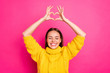 canvas print picture - Close up photo of cheerful girl showing heart figure heart enjoying wearing yellow sweater isolated over fuchsia background