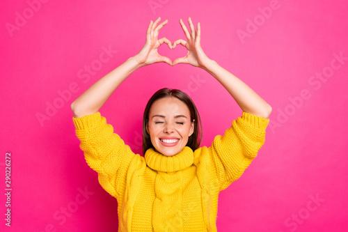 Close up photo of cheerful girl showing heart figure heart enjoying wearing yell Canvas Print