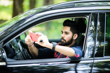Indian Driver Taking Photo Wit...