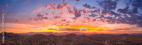 Sunrise panorama over the sonoran desert of Arizona with layers of mountains shot at altitude by a drone Wallpaper Mural