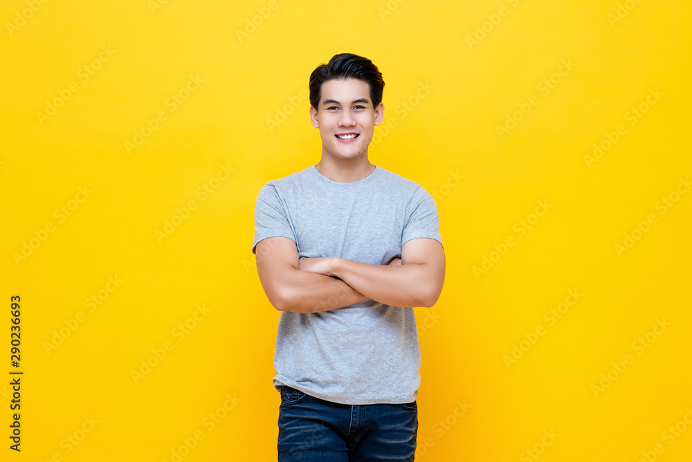 Fototapeta Handsome man standing with crossed arms gesture