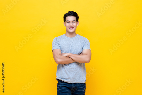 Carta da parati  Handsome man standing with crossed arms gesture