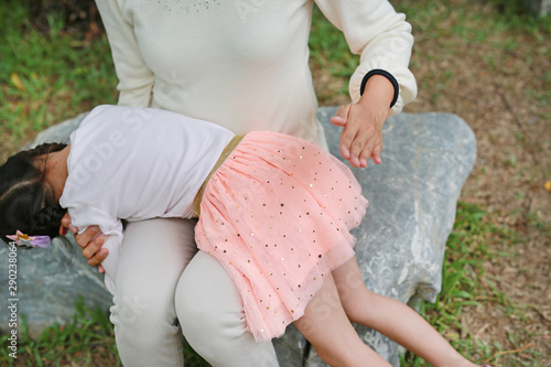 Fotografie, Obraz Mom punishing daughter by hitting with her hand