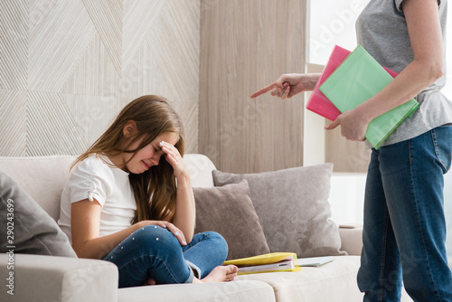 Fotomural Mother scolds school crying daughter for homework
