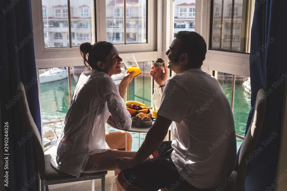 Fototapeta Happy young Couple Enjoying Breakfast .on the terrace at the marina. Relationship and lifestyle concept.