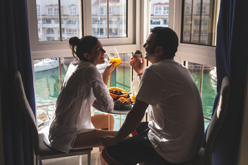 Happy young Couple Enjoying Breakfast .on the terrace at the marina. Relationship and lifestyle concept.