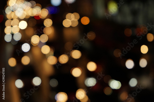 colourful yellow bokeh in black background,city night,space flare,blurry traffic background