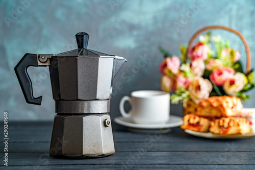 Fotografie, Obraz  Mocha coffee maker, flowers and sweets on dark background for coffee time