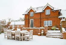 House And Patio In Snow