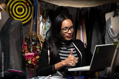 Ladyboy Fashion Designer checks measurement on mannequin Tapéta, Fotótapéta