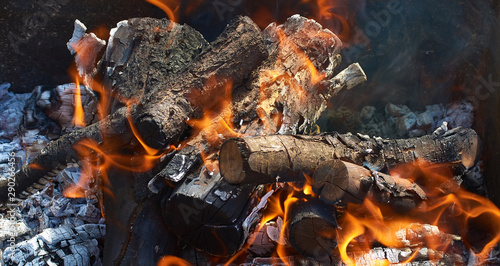 Printed kitchen splashbacks Firewood texture burning firewood for barbecue