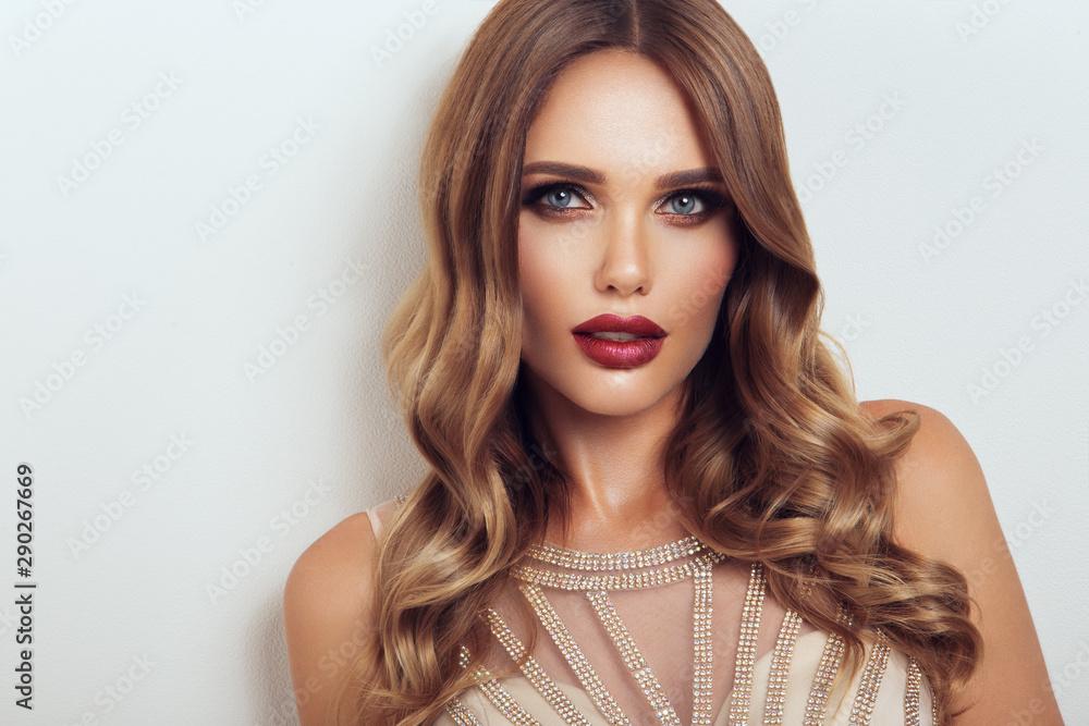 Fototapeta Beautiful model with curly hairstyle. Beautiful make up