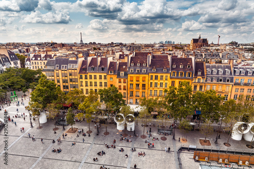 Poster de jardin Paris Aerial view of Pompidou square and residential houses. Eiffel tower at the distance. Paris travel and lifestyle concept