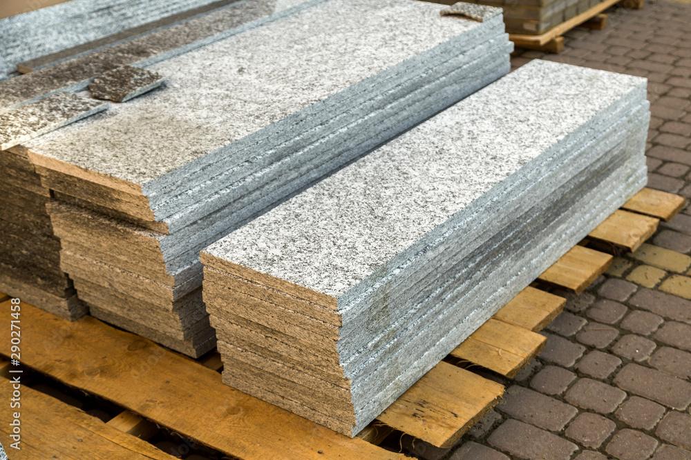 Fototapeta Piles of granite marble slabs.  Stone sheets for decorative construction.