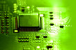 canvas print picture - Selective focus, closeup of integrated electronic circuit in a bright green light