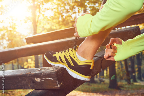 Canvas Prints Textures Preparing for jogging in autumn colored park.