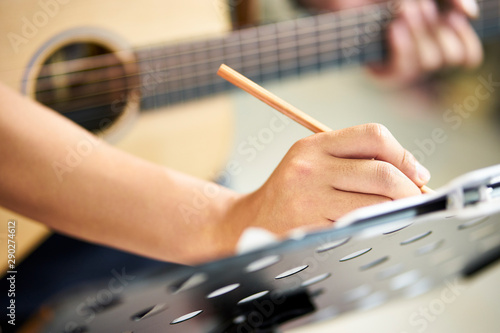 Cuadros en Lienzo  young composer writing down musical notes