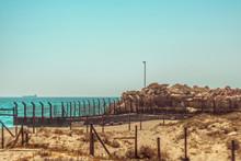 Barbed Wire On The Beach Of La Linea De La Concepcion. Gibraltar Border.