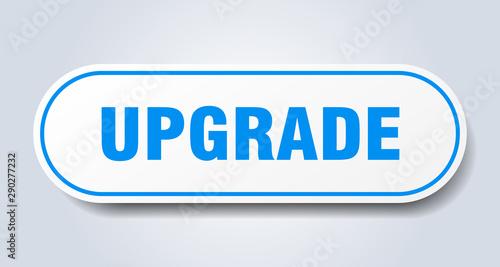 Fotomural  upgrade sign. upgrade rounded blue sticker. upgrade