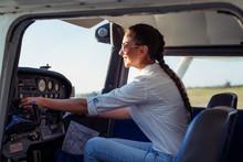 Female Pilot Preparing For A Flight In A Light Aircraft