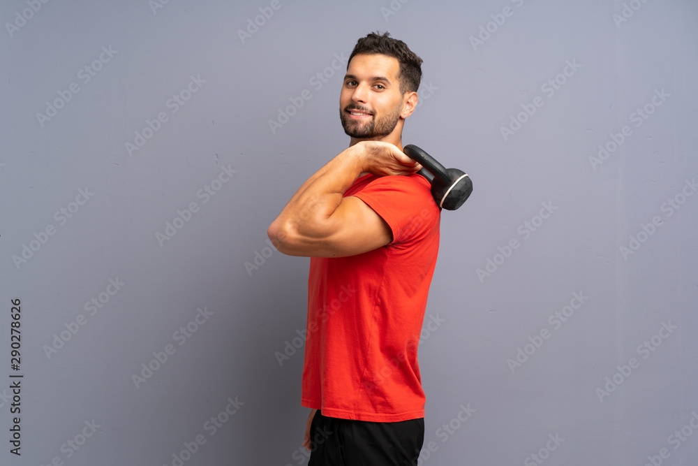 Fototapety, obrazy: Young sport man making kettlebell