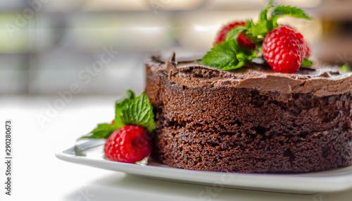 Gluten free tasty round cake based on Belgian chocolate decorated with fresh ras Tapéta, Fotótapéta