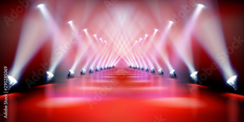 Stage podium illuminated by spotlights during the show. Red carpet. Fashion runway. Vector illustration. - 290285069