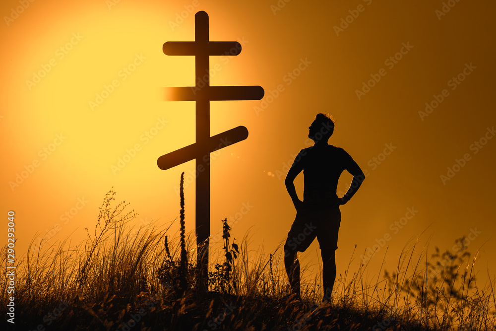 Fototapety, obrazy: Man near orthodox cross on the background of the sunset