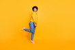 Full length body size profile side view of nice attractive funky childish comic shy girlish wavy-haired girl having fun pout lips posing isolated on bright vivid shine vibrant yellow color background