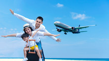 Asian Happy Family Have Fun On The Beach Watching The Landing Planes. Traveling On An Airplane For Leisure And Destination Place Phuket Thialnd Asia.  Family Tourism Travel In Summer And Holiday.