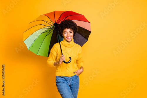 Rainy day is not a problem concept. Photo of positive optimistic cheerful confident feeling in safety pretty hipster person holding open parasol in hand wearing jeans isolated vivid background