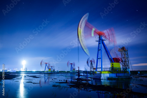 Oil pump at night Wallpaper Mural