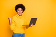 canvas print picture - Portrait of her she nice attractive lovely charming smart clever cheerful wavy-haired girl holding in hands laptop celebrating winning isolated over bright vivid shine vibrant yellow color background
