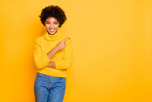 Photo Of Dark Skin Lady Indicating Finger Empty Space Wear Warm Knitted Pullover And Jeans Isolated Yellow Background