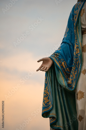 Focus on the hand of the blessed virgin mary,mother of Jesus on the blue sky, in front of the Roman Catholic Diocese, public place in Chanthaburi, Thailand. Wall mural